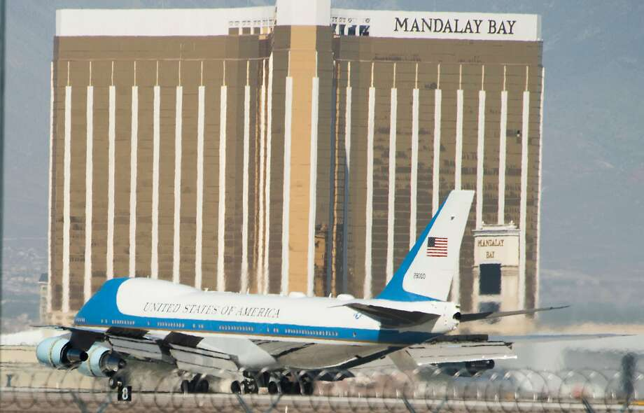 Air Force One with US President Donald Trump and First Lady Melania Trump land at McCarran International Airport in Las Vegas on October 4, 2017, with the Mandalay Bay resort in the background. President Donald Trump arrived Wednesday in Las Vegas, where he will meet survivors of the most deadly mass shooting in modern US history. / AFP PHOTO / Robyn BeckROBYN BECK/AFP/Getty Images Photo: ROBYN BECK, AFP/Getty Images