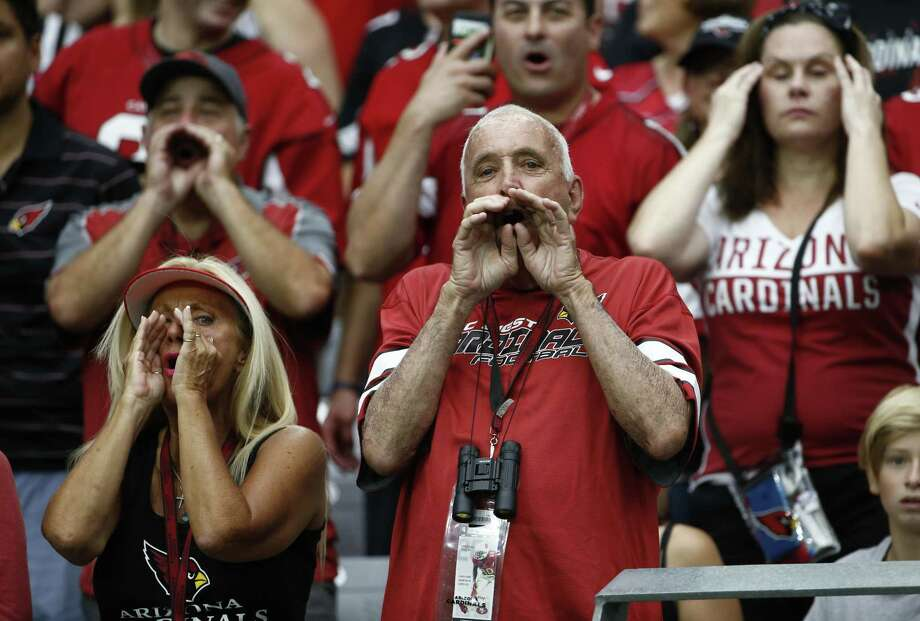 NFL players kneeling during the national anthem have generated much emotion, as shown here as Arizona Cardinals fans yell at San Francisco 49ers players kneeling before an NFL game. It's not about being disrespectful, players say, but  about acknowledging the injustices perpetrated against black Americans and other minorities. Photo: Ross D. Franklin /Associated Press / Copyright 2017 The Associated Press. All rights reserved.