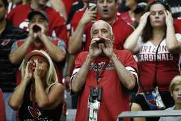NFL players kneeling during the national anthem have generated much emotion, as shown here as Arizona Cardinals fans yell at San Francisco 49ers players kneeling before an NFL game. It's not about being disrespectful, players say, but  about acknowledging the injustices perpetrated against black Americans and other minorities.
