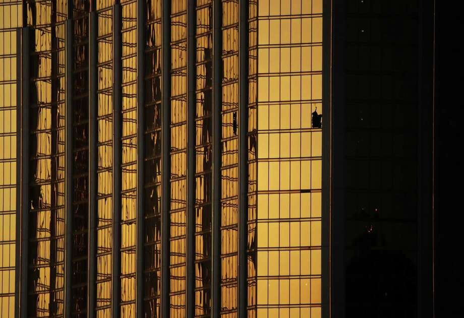 Windows are broken at the Mandalay Bay resort and casino on Tuesday in Las Vegas. Authorities said Stephen Craig Paddock broke the windows and began firing with a cache of weapons, killing dozens and injuring hundreds. Photo: John Locher /Associated Press / Copyright 2017 The Associated Press. All rights reserved.