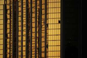 Windows are broken at the Mandalay Bay resort and casino on Tuesday in Las Vegas. Authorities said Stephen Craig Paddock broke the windows and began firing with a cache of weapons, killing dozens and injuring hundreds.
