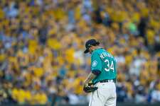 """SEATTLE, WA - JUNE 23: Starting pitcher Felix Hernandez #34 of the Seattle Mariners stands in the pitcher's mound in front the the fan section, """"the King's Court"""" during a game against the Houston Astros at Safeco Field on June 23, 2017 in Seattle, Washington. The Mariners won the game 13-3. (Photo by Stephen Brashear/Getty Images)"""