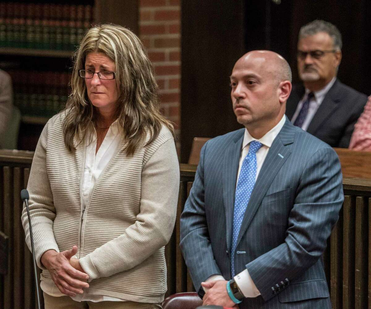 Jean M. Hatalsky, 48, of Mechanicville stands by her attorney Andrew Safranko as she receives her sentence for grand larceny for stealing $500,000 from her former employer Creatacor Company on Thursday Oct. 5, 2017, in Saratoga County Court in Ballston Spa, N.Y. (Skip Dickstein/Times Union)