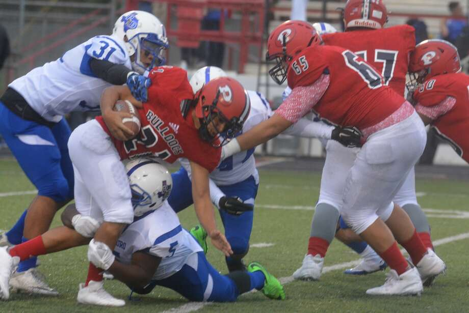 Plainview running back Jerrico Enriquez, 21, strives for extra yardage against Palo Duro last week as teammate Edgar Quiroga, 65, looks to make a block. The Bulldogs will try to rebound from last week's loss when they visit Hereford Friday night. Photo: Skip Leon/Plainview Herald