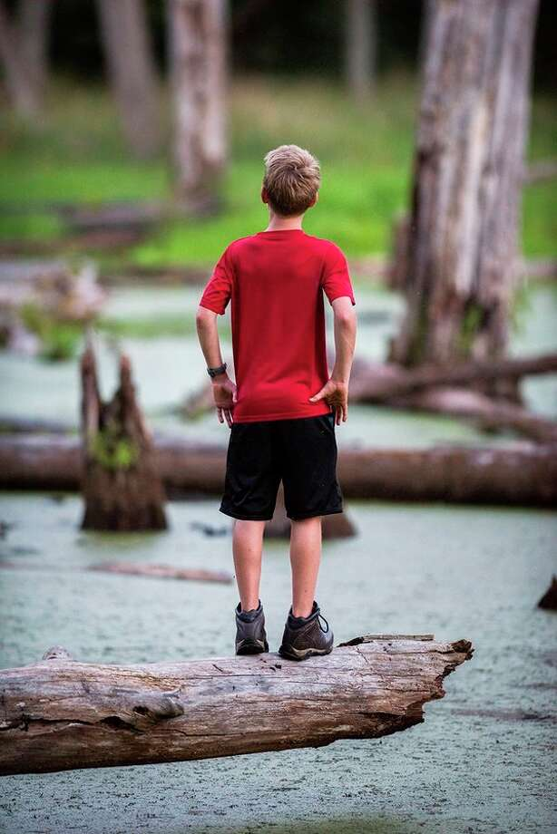 Boy on Log by photojournalist Kent Miller