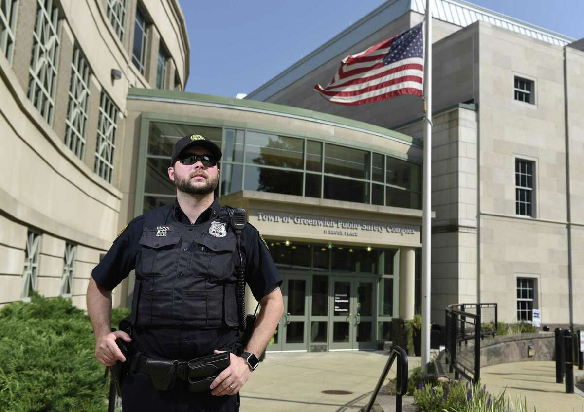 Greenwich Patrol Officer Dan Bucci poses outside the Town of Greenwich Public Safety Complex in Greenwich, Conn. Tuesday, Sept. 5, 2017.