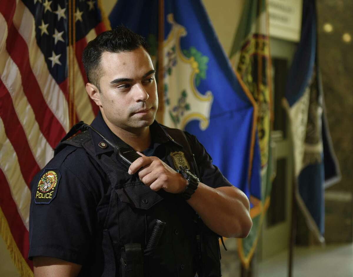 Greenwich Patrol Officer Justin Rivera poses in the lobby of the Town of Greenwich Public Safety Complex in Greenwich, Conn. Tuesday, Sept. 5, 2017.