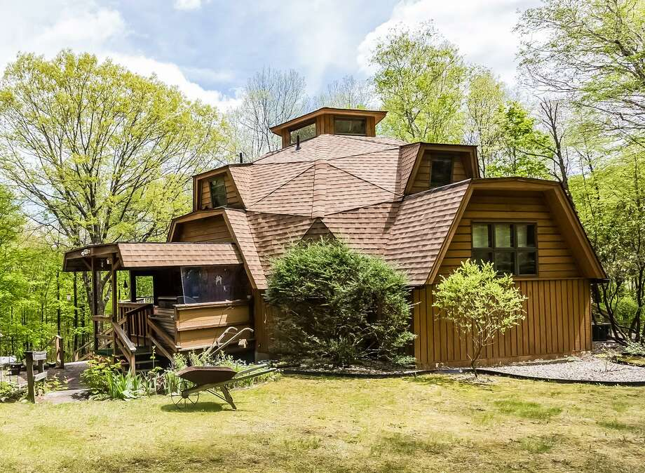 The unique contemporary at 35 Sawyer Hill in New Milford was designed by the owner to be energy efficient. It features a 10-sided geodesic dome. Photo: Contributed Photos / © 2017 PlanOmatic The News-Times Contributed