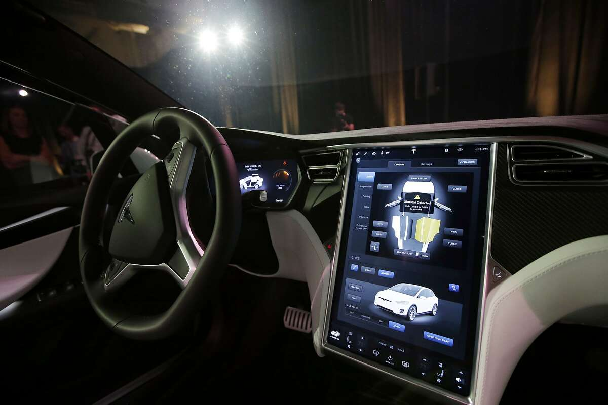 FILE - This Tuesday, Sept. 29, 2015, file photo shows the dashboard of the Tesla Model X car, at the company's headquarters in Fremont, Calif. Newer cars that connect to the internet are capable of collecting vast amounts of data about their drivers. Tesla Motors has used data to reveal, sometimes within hours of a crash, how fast the driver was going and whether or not the company�s semi-autonomous Autopilot system was engaged. (AP Photo/Marcio Jose Sanchez, File)