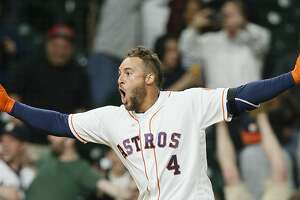 HOUSTON, TX - APRIL 05:  George Springer #4 of the Houston Astros celebrates after hitting a three run home run in the thirteenth inning to give them a 5-3 win at Minute Maid Park on April 5, 2017 in Houston, Texas.  (Photo by Bob Levey/Getty Images)
