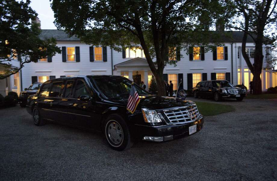 Limousines and motorcade vehicles for President Barack Obama are seen parked in the driveway outside the residence of movie producer Harvey Weinstein and fashion designer Georgina Chapman, Monday, Aug., 6, 2012 in Westport, Conn. Obama is attending a private dinner with 60 attendees at the residence. (AP Photo/Pablo Martinez Monsivais) Photo: Pablo Martinez Monsivais / Associated Press / AP