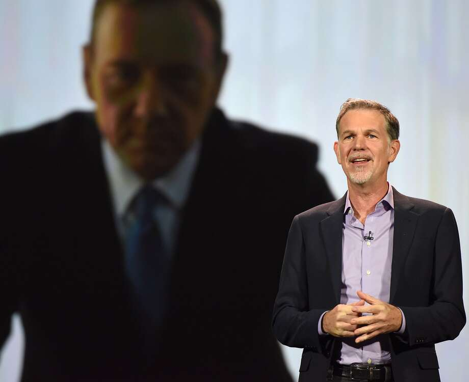 "Netflix CEO Reed Hastings gives a speech at CES last year, under the gaze of Kevin Spacey from ""House of Cards."" Photo: ROBYN BECK, AFP / Getty Images"
