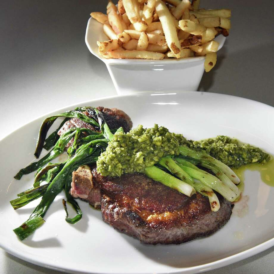 Kinderhook ribeye steak with scallions and garlic scape chimichurri at Aeble restaurant on Warren Street Thursday Sept. 28, 2017 in Hudson,NY.  (John Carl D'Annibale / Times Union) Photo: John Carl D'Annibale / 40041688A