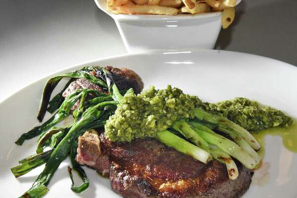 Kinderhook ribeye steak with scallions and garlic scape chimichurri at Aeble restaurant on Warren Street Thursday Sept. 28, 2017 in Hudson,NY.  (John Carl D'Annibale / Times Union)