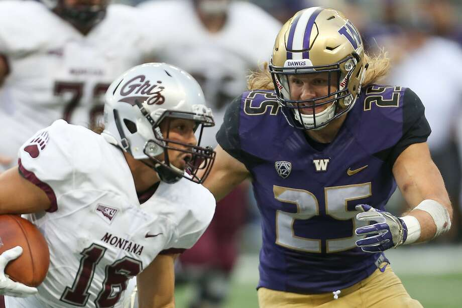 Washington linebacker Ben Burr-Kirven, who went to Sacred Heart Prep-Atherton, tackles Montana wide receiver Jerry Louie-McGee on Saturday, Sept. 9, 2017. The 6-foot, 222-pound inside linebacker has 38 tackles for the 5-0 Huskies along with a sack. No one else on the team has more than 21 tackles. Photo: GRANT HINDSLEY, SEATTLEPI.COM