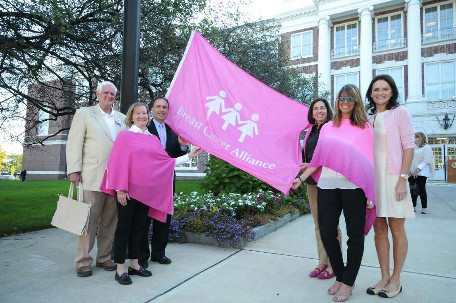 The team preparing to raise the Breast Cancer Alliance's flag outside of Town Hall. From left is Selectman John Toner; Barbara Ward, director of Greenwich Hospital's breast care services; First Selectman Peter Tesei; BCA Go for Pink chairman Loren Taufield; BCA Executive Director Yonni Wattenmaker and BCA Board President Mary Jeffery. Photo: Bob Capazzo; Contributed