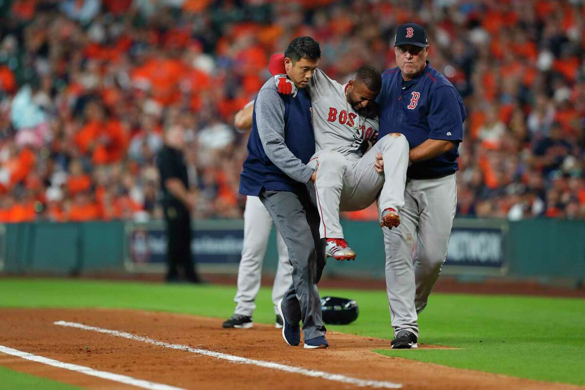 Boston Red Sox second baseman Eduardo Nunez is carried off the field during the first inning of Game 1 of the ALDS at Minute Maid Park on Thursday, Oct. 5, 2017, in Houston.