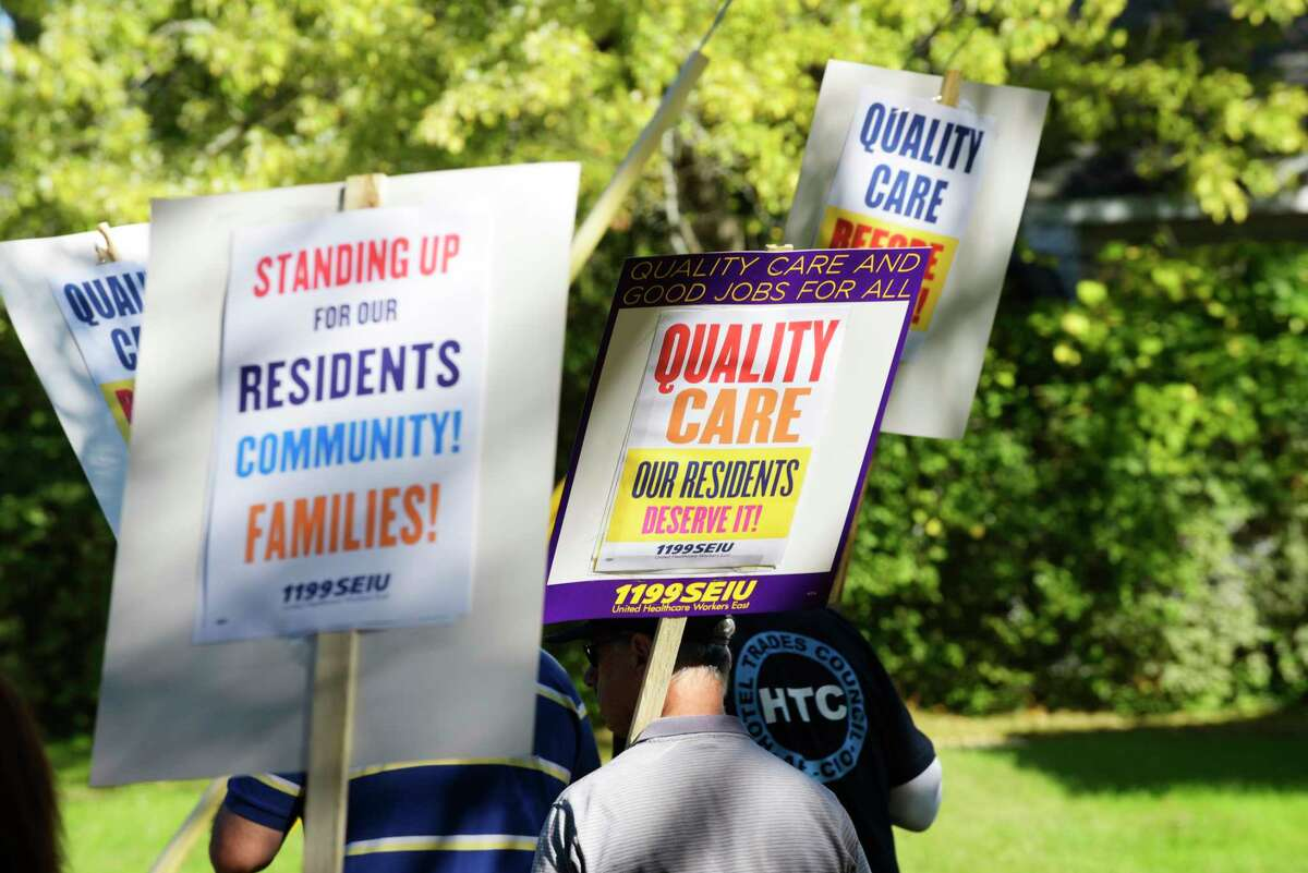 Members of 1199 SEIU Healthcare Workers, other labor leaders and some elected officials take part in a picket outside The Grand Rehabilitation and Nursing on Thursday, Oct. 5, 2017, in Guilderland, N.Y. (Paul Buckowski / Times Union)