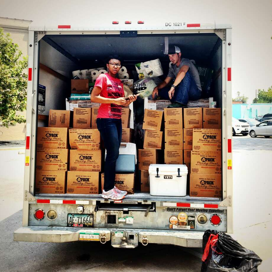 A truck is loaded with supplies at the Giving Hub. Photo: David Leftwich