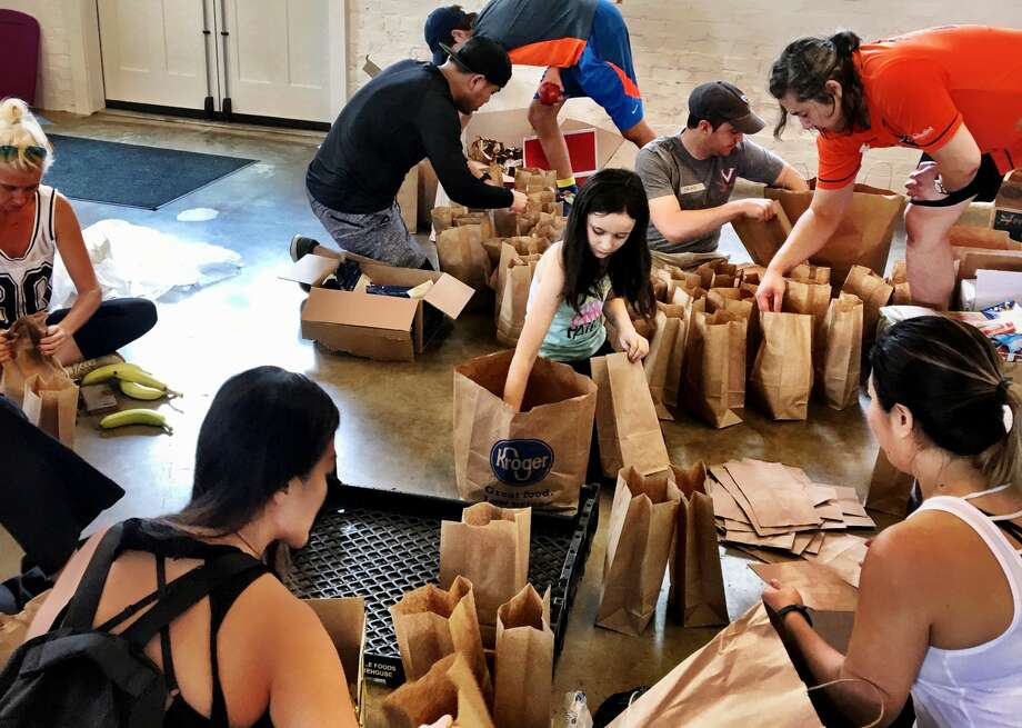 Volunteers pack sandwiches at the Giving Hub. Photo: David Leftwich
