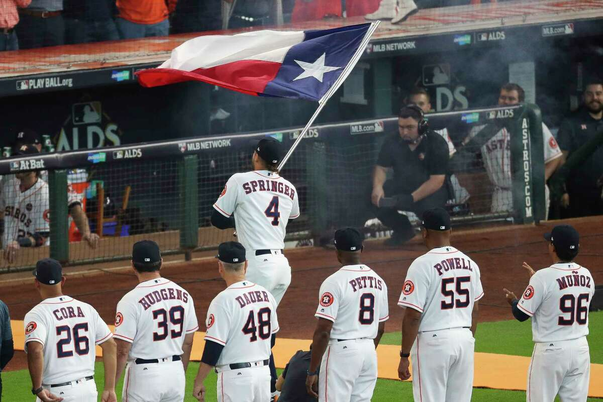 PHOTOS: A look at the pregame festivities before Thursday's Game 1 Houston Astros center fielder George Springer runs onto the field with the Texas flag before the Houston Astros take on the Boston Red Sox during the first game of the American League Divisional Series at Minute Maid Park Thursday, Oct. 5, 2017 in Houston. Browse through the photos for a look at the Astros' pregame festivities Thursday.