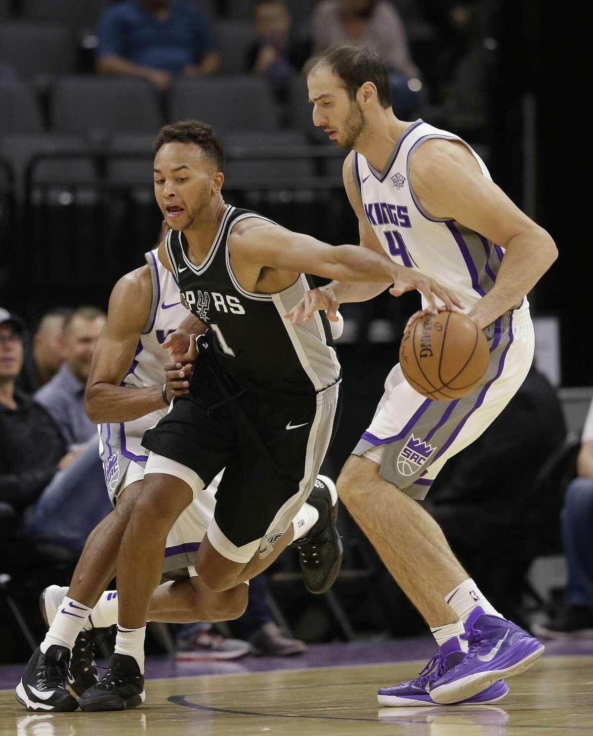 Spurs guard Kyle Anderson steals a pass intended for Kings center Kosta Koufos during the first quarter of a preseason game on Oct. 2, 2017, in Sacramento, Calif.