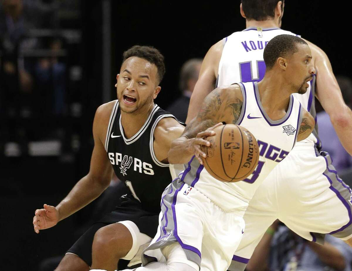 Kings guard George Hill gets away from Spurs guard Kyle Anderson during the first quarter of a preseason game on, Oct. 2, 2017, in Sacramento, Calif.