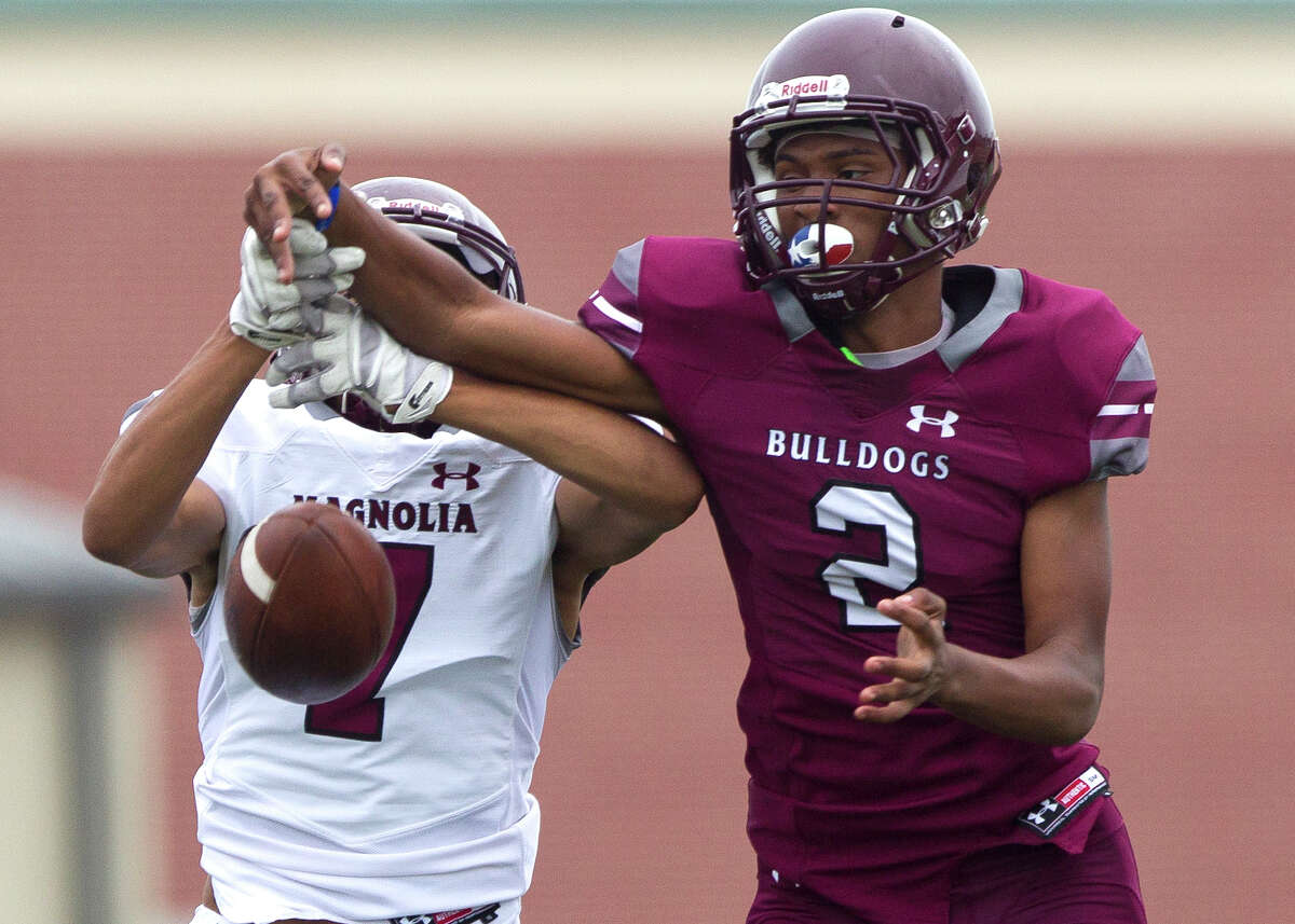 Magnolia cornerback Jaden Floyd (2) break up a pass intended for wide reciever Jordan Ratcliff (7) during a spring high school football game Wednesday, May 17, 2017, in Magnolia.