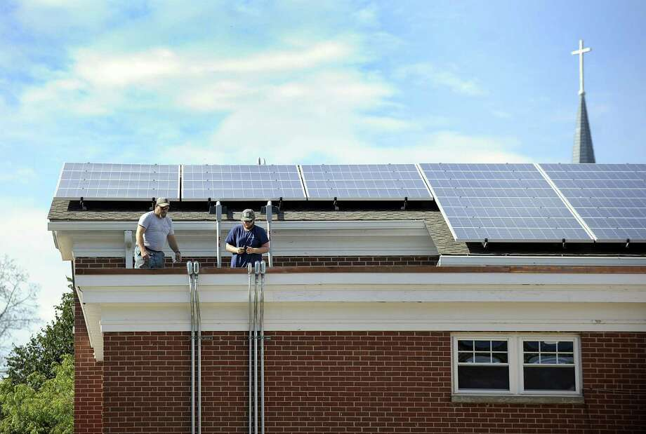 St. Joseph Church in Brookfield installed 475 solar panels on its school over the summer. The panels will power the church, rectory and parish center and go live on Thursday, Oct. 5, 2017. Photo: Carol Kaliff / Hearst Connecticut Media / The News-Times