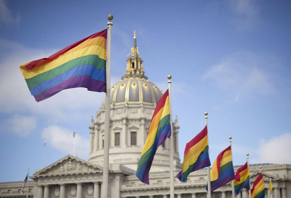 Rainbow flags fly in front of San Francisco City Hall, Wednesday, June 26, 2013, shortly after the U.S. Supreme Court decision that cleared the way for same-sex marriage in California. (AP Photo/Noah Berger)