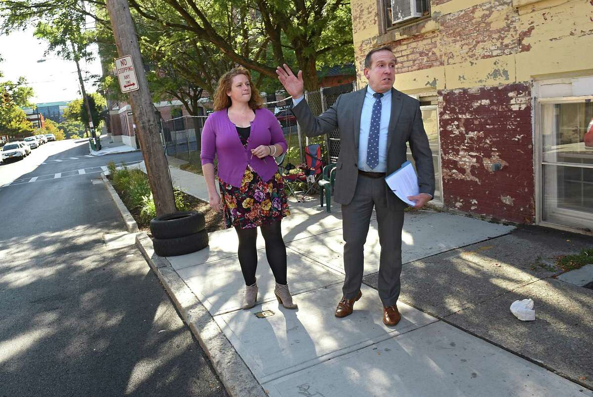 Kristen Holler, executive director of the Albany Barn, and Steve Longo, executive director of the Albany Housing Authority, point out potential spaces along North Swan Street on Monday, Oct. 2, 2017 in Albany, N.Y. On Friday, October 6 the Albany Housing Authority and Albany Barn are hosting a block party to kickoff He(Art) of The Hill, an initiative to establish North Swan Street as a hub for the art community and attract businesses to help revitalize the neighborhood. (Lori Van Buren / Times Union)