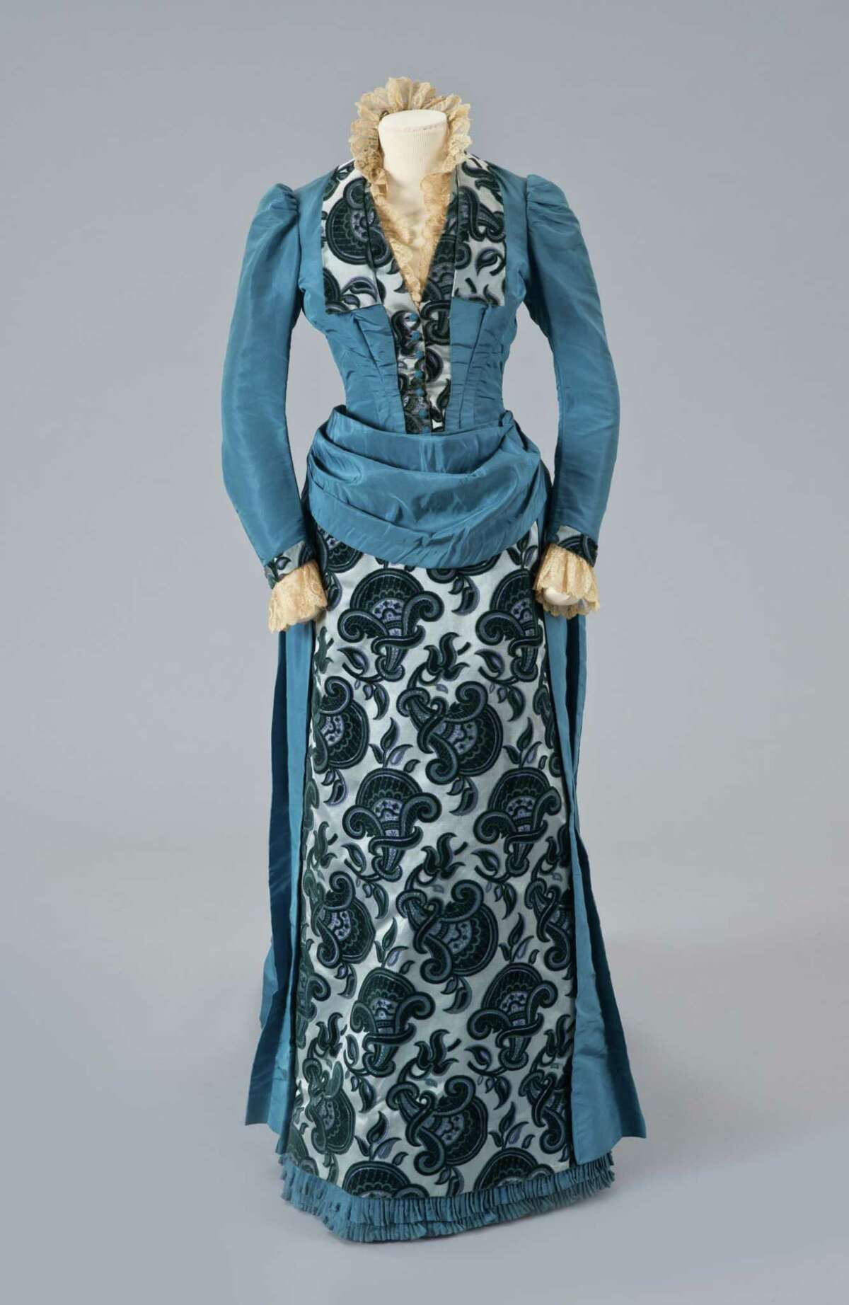Blue Dress with Velvet Panel Label: Mme Amédée Francois / Robes & Confections / 76, Rue Truve des Petits Champs (Paris) Silk with silk velvet, lace c.1889 Gift of Eliza Ten Eyck Pruyn Robinson from the Estate of Margaret and Foster Pruyn (Image from the Albany Institute of History and Art / Photo by Michael Fredericks)