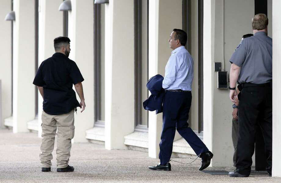 Sen. Carlos Uresti, D-San Antonio, is escorted by law enforcement officials to the Federal Courthouse on Wednesday, May 17, 2017. Uresti is facing 13 different charges involving bribery, wire fraud, and conspiracy for his involvement in the bankrupt frac-sand company, Four Winds Logistics. Photo: Jerry Lara, Staff / San Antonio Express-News / 2017 San Antonio Express-News
