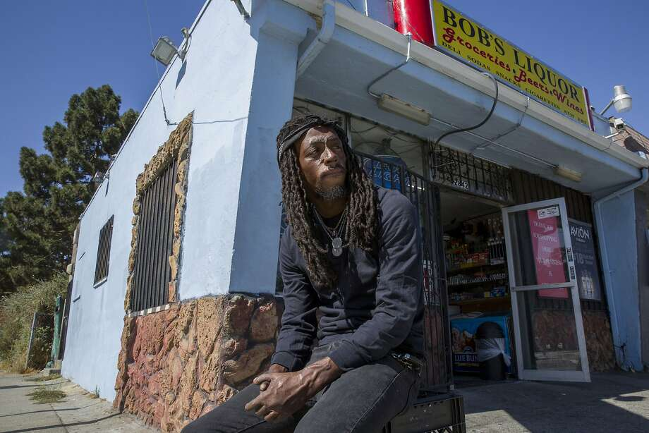 "Koran Streets, a rapper and actor, sits outside the liquor store near where he sold drugs. Streets, who is now ""reformed"" from his criminal past, uses his art to tell the stories of marginalized communities. Photo: Santiago Mejia, The Chronicle"