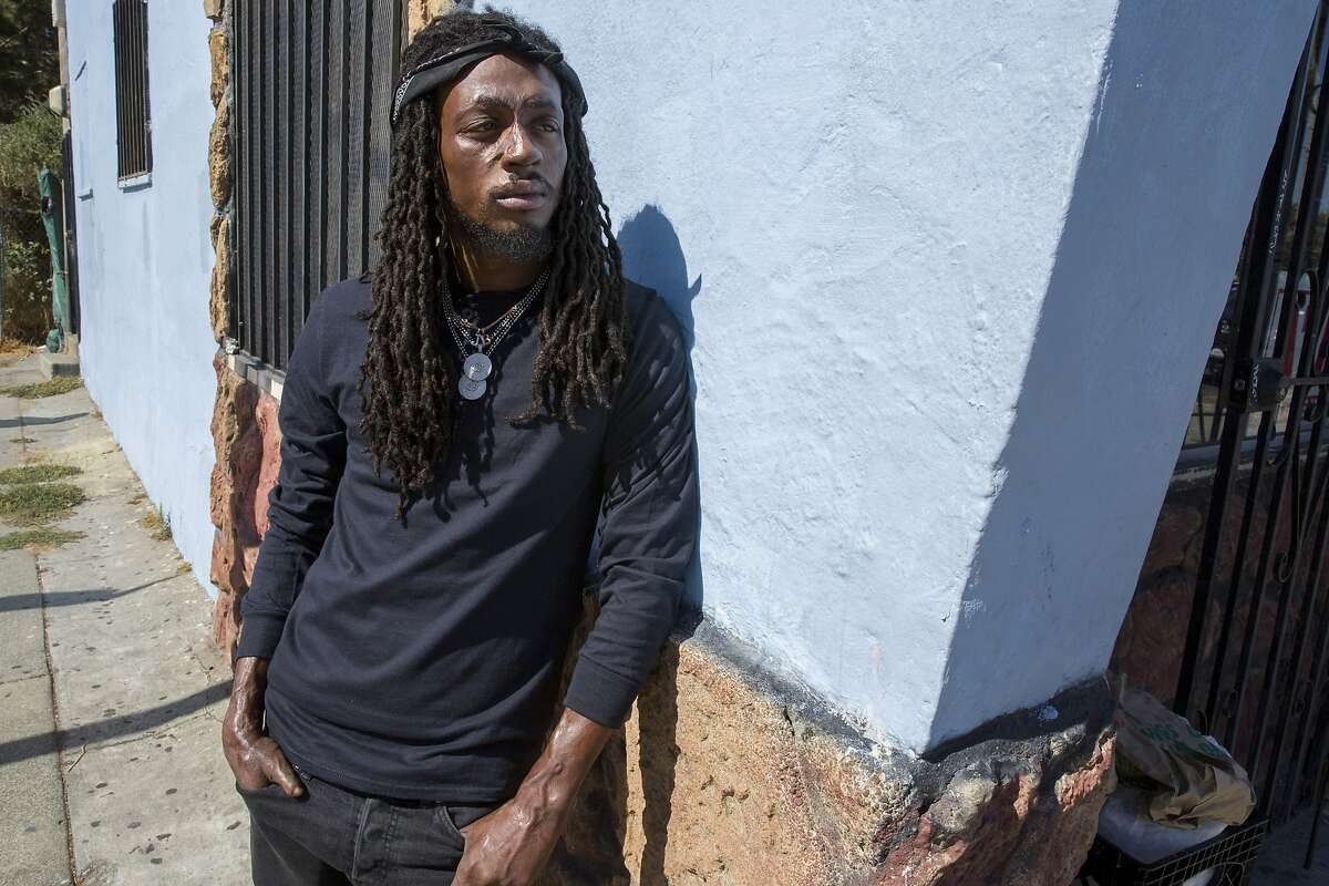 """Koran Streets stands for a portrait at Bob's Liquors on Wednesday, Oct. 4, 2017, in Berkeley, Calif. Koran Streets is a rapper and his album, """"You.Know.I.Got.It (The Album),"""" was ranked 28th in Rolling Stones 40 Best Rap Albums of 2016. He grew up in Berkeley and the liquor store was his go-to for groceries."""