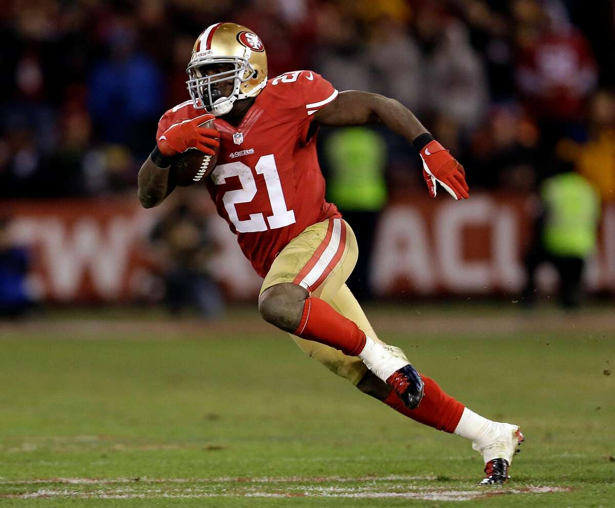 In this Jan. 12, 2013, file photo, San Francisco 49ers running back Frank Gore (21) runs against the Green Bay Packers during the fourth quarter of an NFC divisional playoff NFL football game in San Francisco.