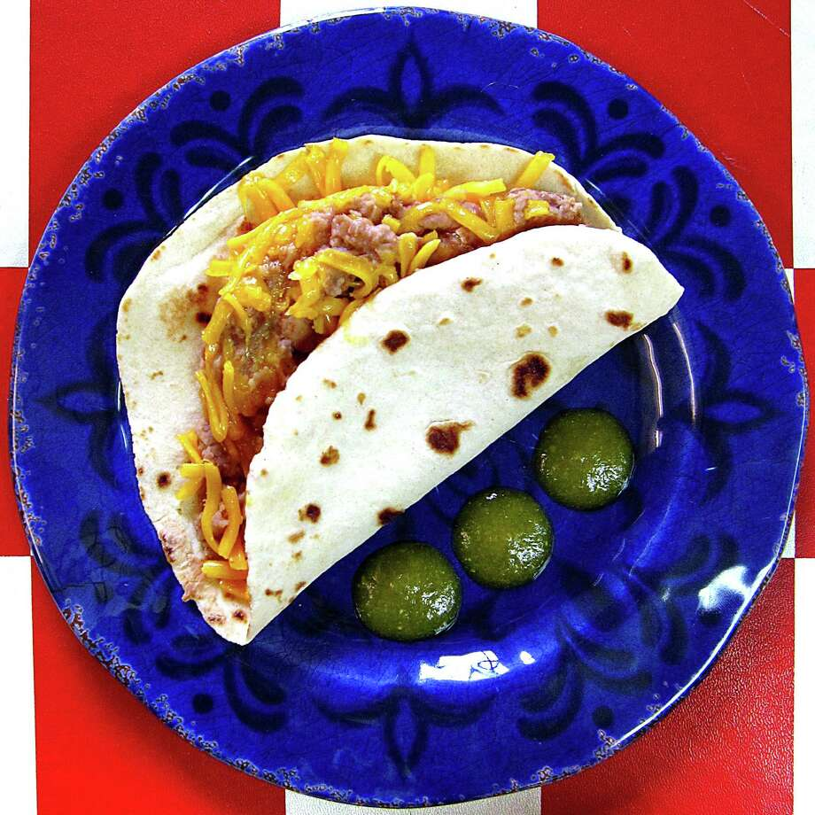 Bean and cheese taco on a handmade flour tortilla from Don Burger Taco. Photo: Mike Sutter /San Antonio Express-News