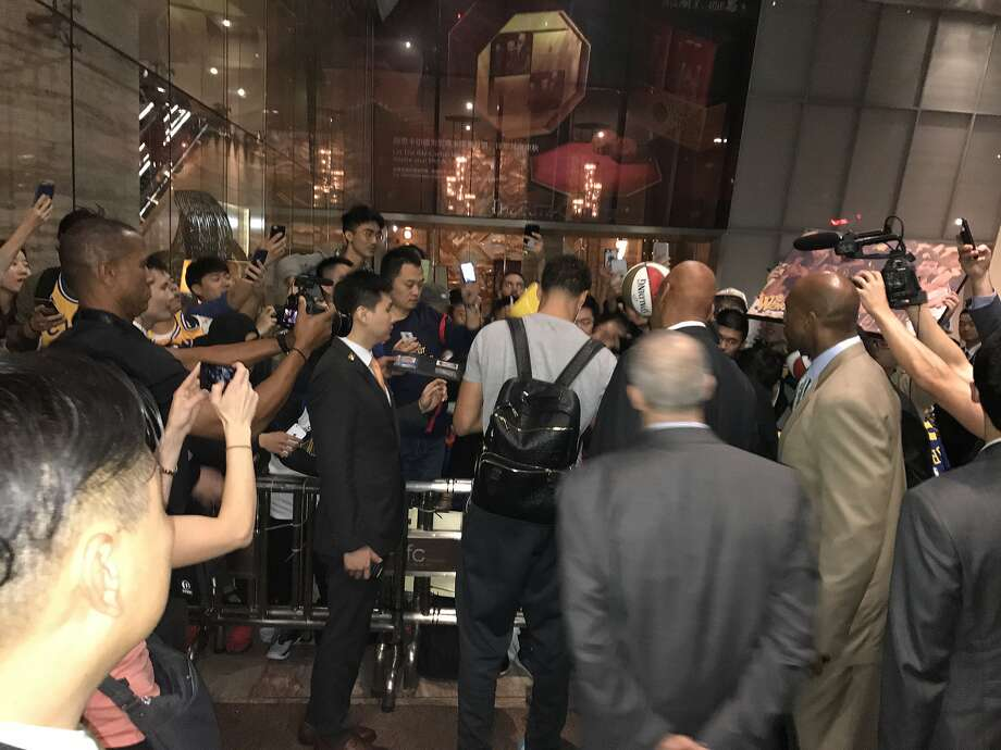 Klay Thompson signs autographs for Chinese fans outside the Warriors' hotel in Shanghai. Photo: Connor Letourneau