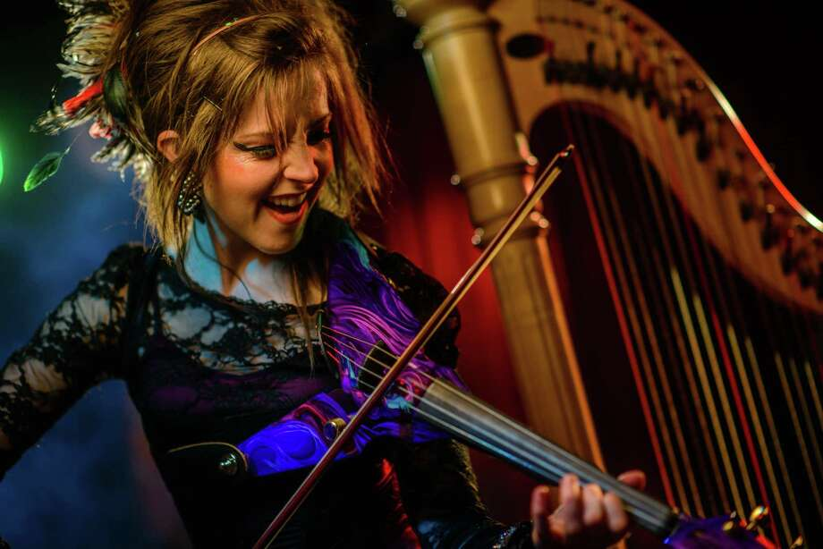 Violinist Lindsey Stirling is a dancer as well as a musician, and she'll perform at the New Milford High School theater on Saturday, Sept. 22. Her YouTube videos have received more than 124 million views; this is your chance to see her live. Photo: Contributed Photo / The News-Times Contributed