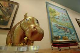 Sue Shefman opens her hippo house for photos Friday, Sept. 23, 2016, in Houston. Shefman has about 2000 hippo collections and her house would be featured in the First Annual Weird Homes Tour Houston.