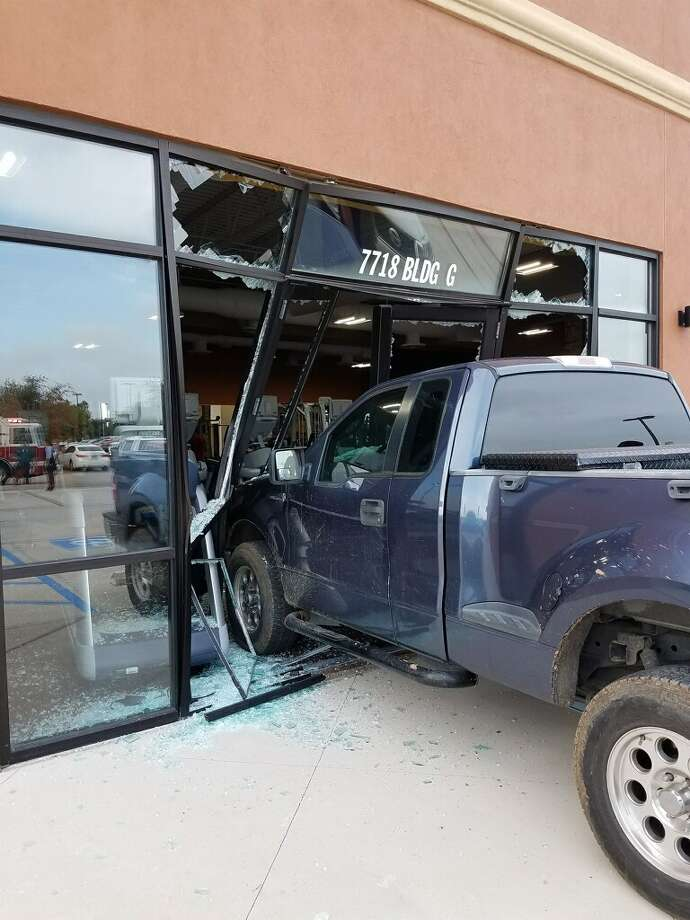 An elderly man crashed his blue pickup into a north Laredo fitness center Wednesday morning, according to first responders. Photo: Laredo Fire Department
