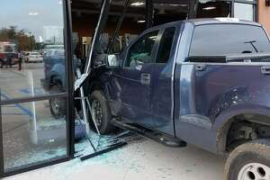An elderly man crashed his blue pickup into a north Laredo fitness center Wednesday morning, according to first responders.