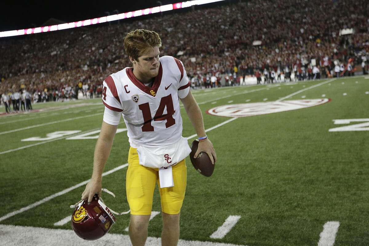 Southern California quarterback Sam Darnold (14) sets his helmet down before an NCAA college football game against Washington State in Pullman, Wash., Friday, Sept. 29, 2017. (AP Photo/Young Kwak)