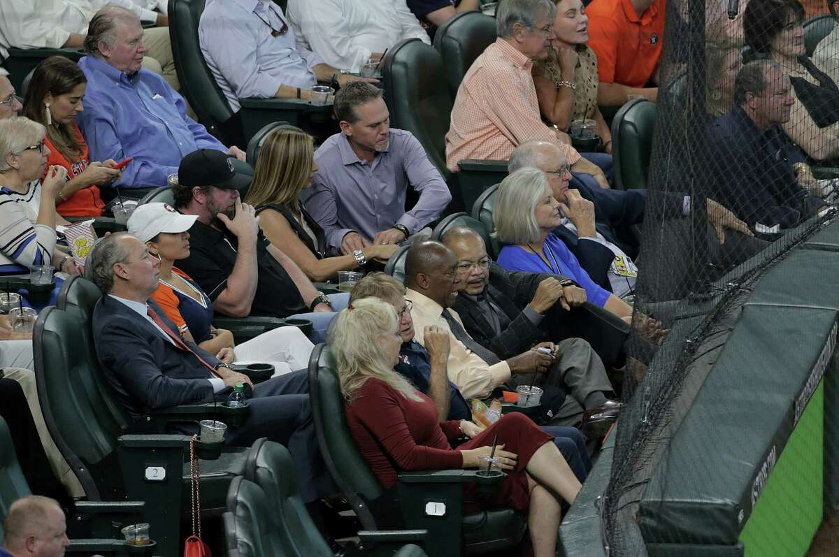 Astro Royalty hang out behind home plate during game ALDS Game 1 between the Boston Reds Sox and the Houston Astros at Minute Maid Park on Thursday, Oct. 5, 2017, in Houston.