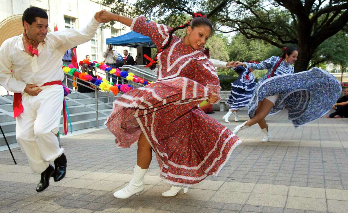 Alejandro Lopez, left, and Ashley Solorzano, with Jocelyn Villalobos, far right, of Grupo Folklorico Xochipilli, perform during the kickoff event in front of City Hall for Hispanic Heritage Month Thursday, Sept. 15, 2011, in Houston. ( Brett Coomer / Houston Chronicle )