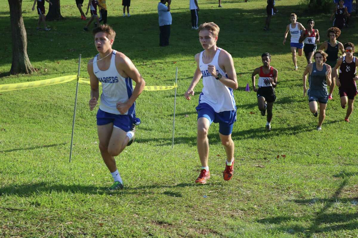 Two Clear Springs runners navigate Heartbreak Hill during Thursday's cross country race in Pasadena. The Chargers captured second place in Division II with 59 points.