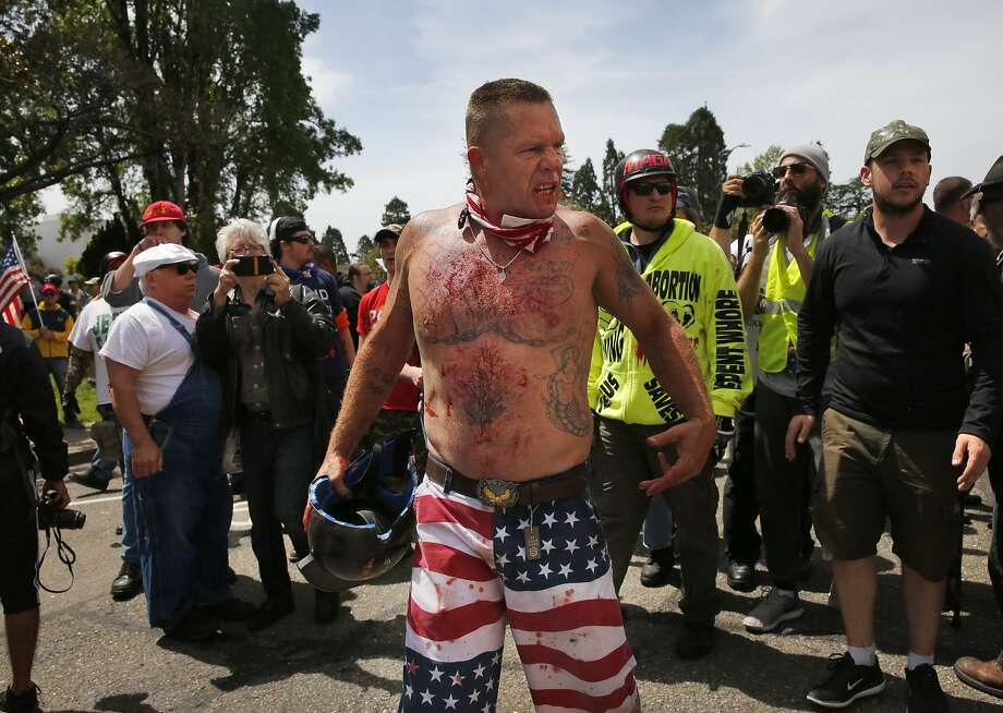 """A Trump supporter threatens anti-fascist protesters after getting into skirmishes with them on Center Street during a rally called """"Patriot's Day Free Speech Rally"""" in Martin Luther King Jr. Civic Center Park April 15 in Berkeley. Photo: Leah Millis, The Chronicle"""