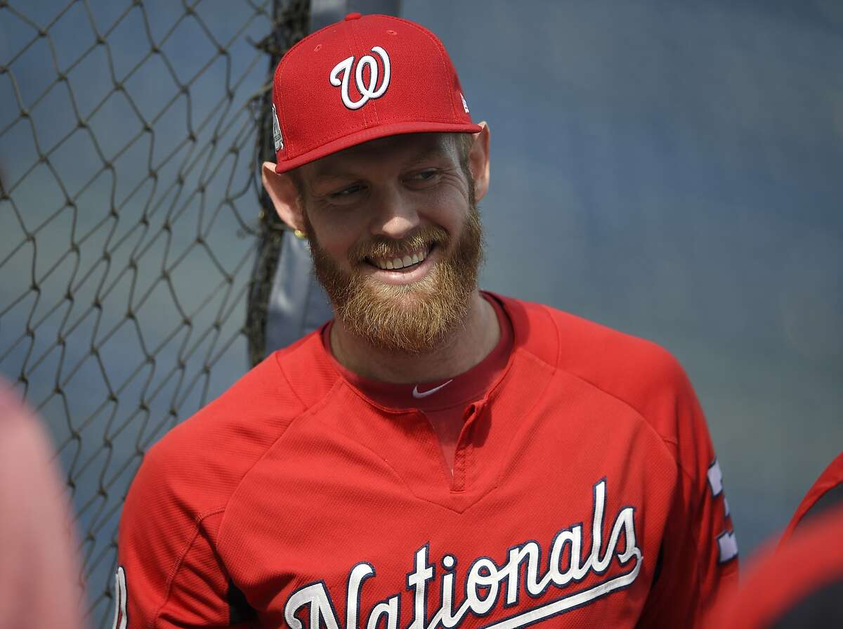 Washington Nationals' Stephen Strasburg smiles during baseball practice at Nationals Park, Thursday, Oct. 5, 2017, in Washington. Strasburg is slated to start Game 1 of the National League Division Series against the Chicago Cubs in on Friday. (AP Photo/Nick Wass)