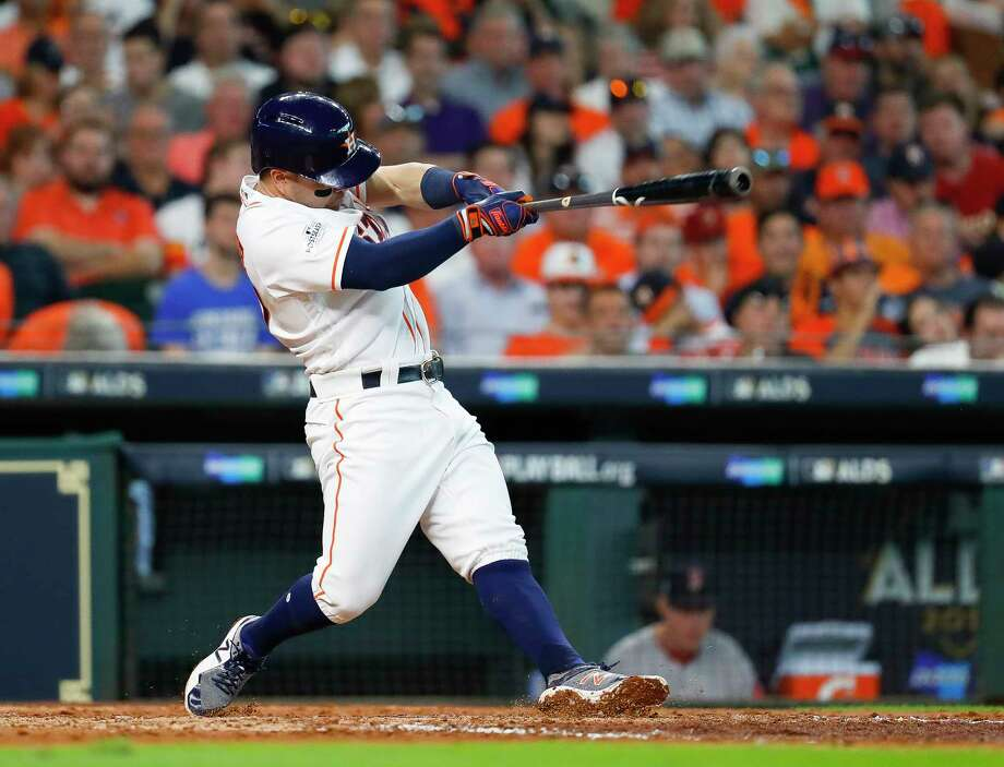 Houston Astros second baseman Jose Altuve  hits a fifth inning solo home run during Game 1 of the ALDS at Minute Maid Park on Tuesday, Oct. 3, 2017, in Houston. Photo: Karen Warren, Houston Chronicle / @ 2017 Houston Chronicle