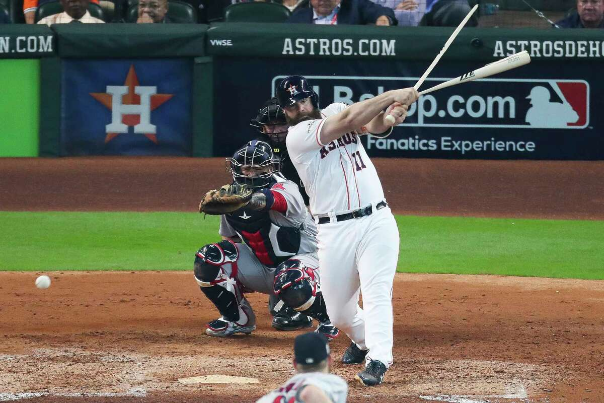Houston Astros catcher Evan Gattis breaks his bat as the Houston Astros take on the Boston Red Sox during the fourth inning of the first game of the American League Divisional Series at Minute Maid Park Thursday, Oct. 5, 2017 in Houston.